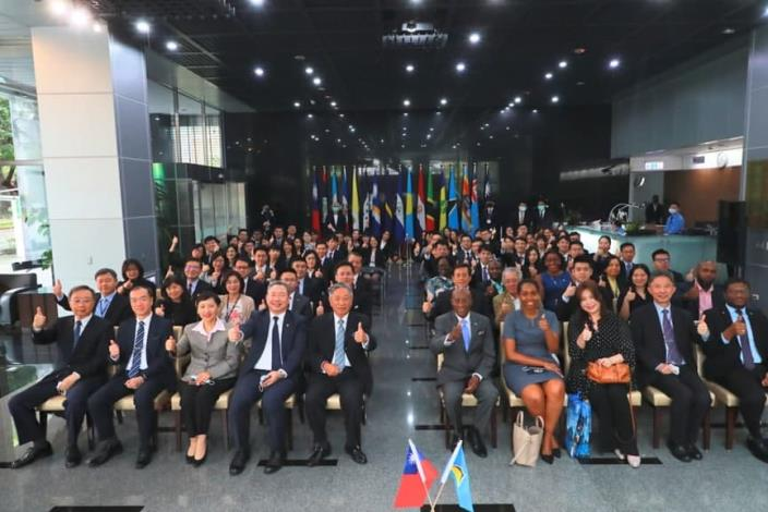 Caption[3]: Group photo of diplomatic officers attending the signing ceremony.